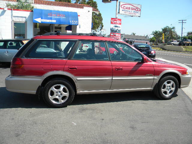 subaru legacy 1998 red wagon outback limited gasoline 4. Black Bedroom Furniture Sets. Home Design Ideas
