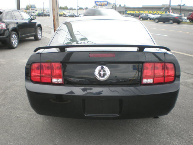 ford mustang 2006 black coupe gasoline 6 cylinders rear. Black Bedroom Furniture Sets. Home Design Ideas