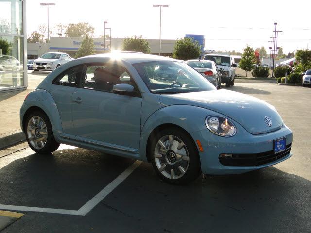 volkswagen beetle  denim blue gasoline  cylinders front wheel drive automatic