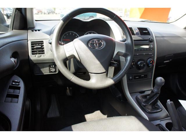 toyota corolla 2009 black sedan s gasoline 4 cylinders front wheel drive 5 speed manual 47172. Black Bedroom Furniture Sets. Home Design Ideas