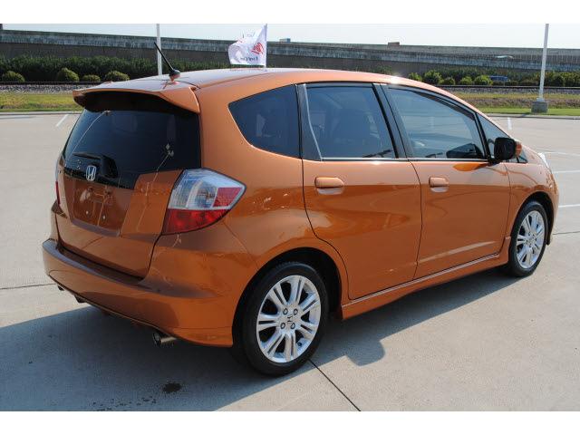 honda fit 2009 orange hatchback sport gasoline 4 cylinders front wheel drive automatic 77065. Black Bedroom Furniture Sets. Home Design Ideas