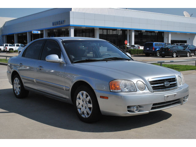 kia optima 2004 silver sedan lx gasoline 4 cylinders front. Black Bedroom Furniture Sets. Home Design Ideas