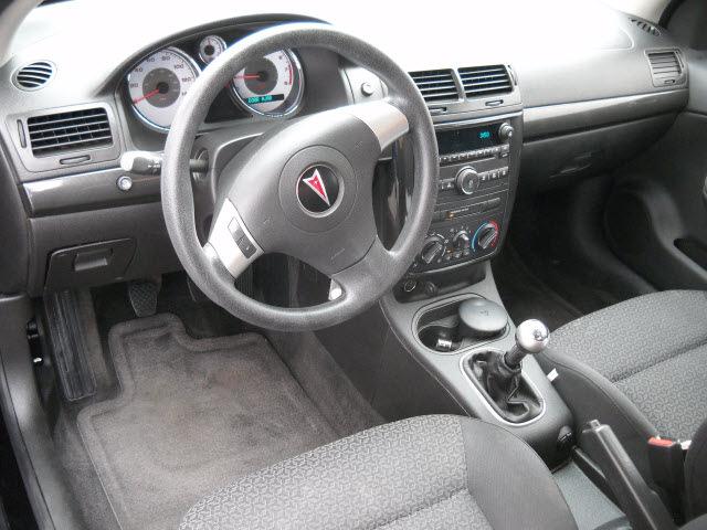 pontiac g5 2009 black coupe gasoline 4 cylinders front wheel drive Pontiac G5 Rims pontiac g5 2009 black coupe gasoline 4 cylinders front wheel drive standard 79925