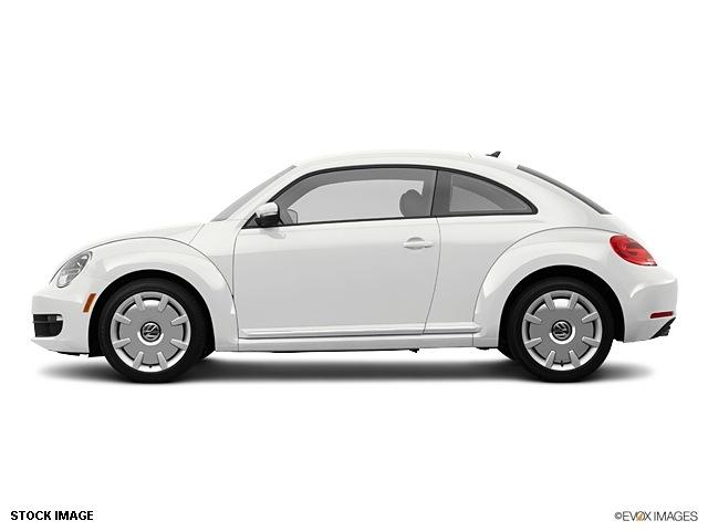 volkswagen beetle  white hatchback   pzev gasoline  cylinders front wheel drive  speed