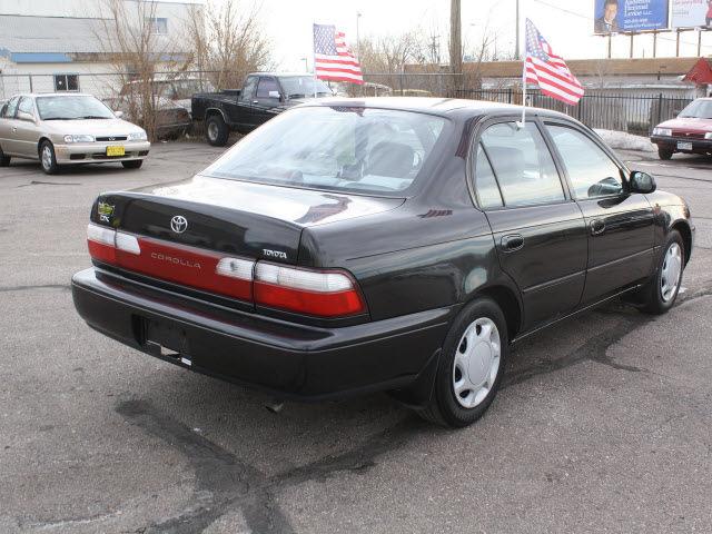toyota corolla 1997 black sedan dx gasoline 4 cylinders front wheel drive 5 speed manual 80229. Black Bedroom Furniture Sets. Home Design Ideas