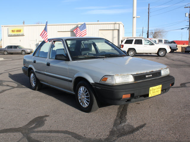 toyota corolla 1990 silver sedan deluxe gasoline 4 cylinders front wheel drive 5 speed manual. Black Bedroom Furniture Sets. Home Design Ideas