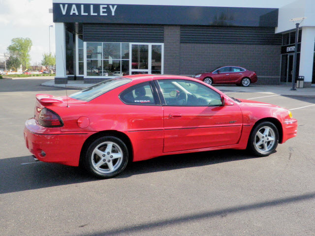pontiac grand am 1999 red coupe gt gasoline v6 front wheel drive automatic 55124 pontiac grand am 1999 red coupe gt gasoline v6 front wheel drive automatic 55124 cars car photos share your car photo car photos share your car photo