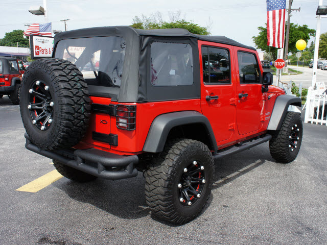 jeep wrangler unlimited 2011 red suv sport gasoline 6 cylinders 4 wheel drive 6 speed manual. Black Bedroom Furniture Sets. Home Design Ideas