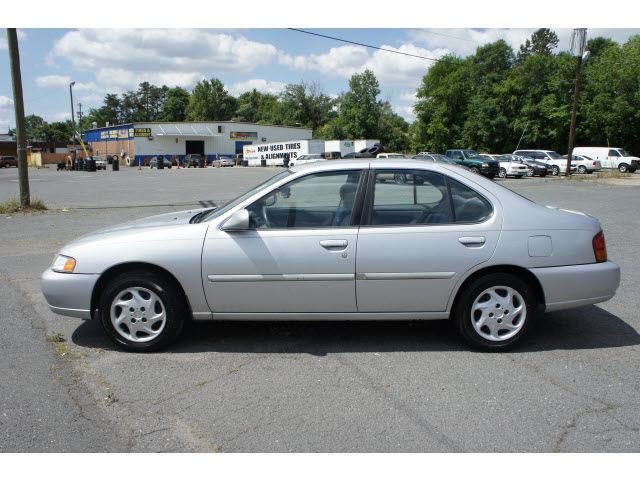 nissan altima 1999 silver sedan gxe gasoline 4 cylinders front
