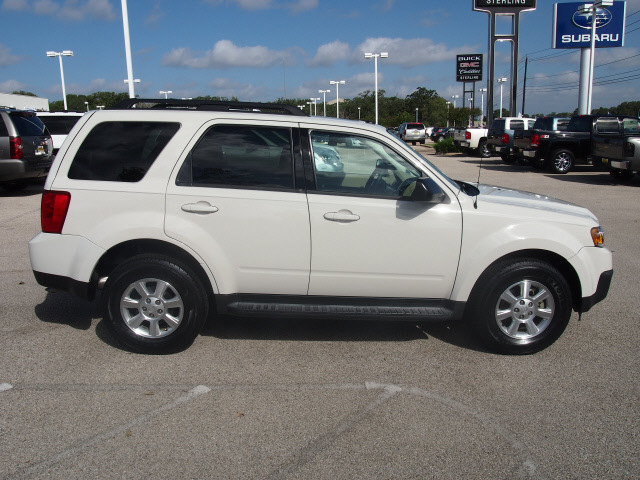 mazda tribute 2009 off white suv i grand touring gasoline 4 cylinders front wheel drive. Black Bedroom Furniture Sets. Home Design Ideas