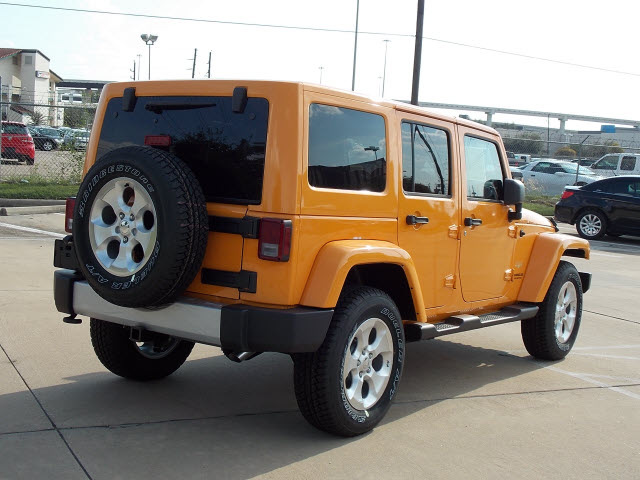 jeep wrangler unlimited 2013 orange suv sahara gasoline 6 cylinders 4 wheel drive automatic with. Black Bedroom Furniture Sets. Home Design Ideas