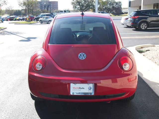 volkswagen  beetle  red hatchback gasoline  cylinders front wheel drive  speed manual